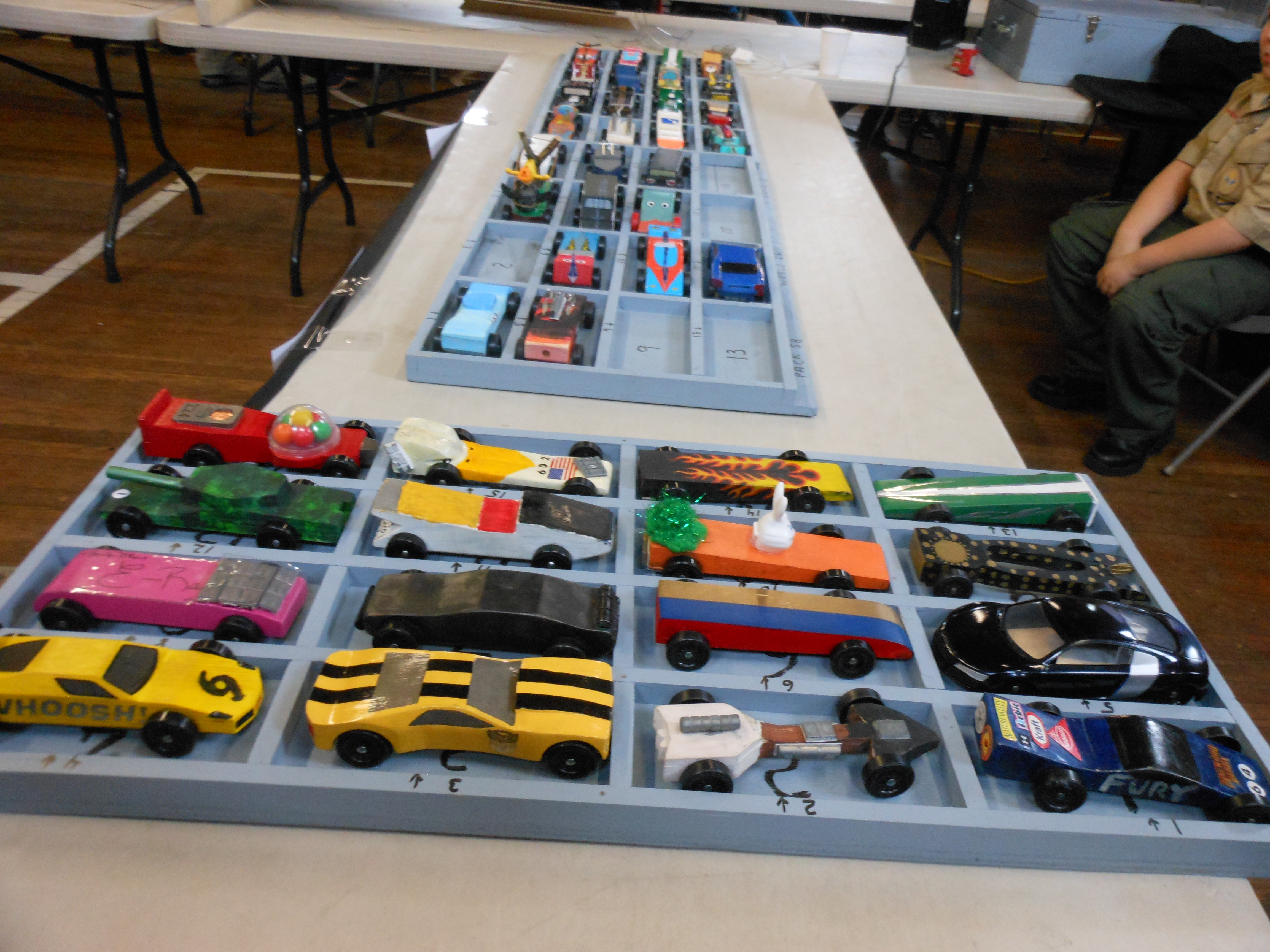 THE FIELD OF COMPETITORS: These are the cars that competed last Saturday in Saugus Cub Scout Pack 62's annual Pinewood Derby, which was held in the basement of Cliftondale Congregational Church. (Saugus Advocate photos by Mark E. Vogler)