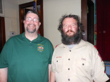 TOP TWO SCOUT LEADERS: Saugus's two scoutmasters – Boy Scout Troop 61 leader Kevin M. Wildman and Troop 62 leader John Kane – reminisced about their racing days at Saugus Cub Scout Pack 62's Annual Pinewood Derby last Saturday in the basement of Cliftondale Congregational Church.