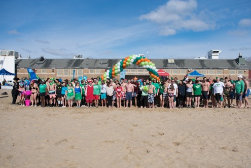 Splashers line up on the beach ready to take the plunge at the 2018 Harpoon Shamrock Splash. (Photo by Katy Rogers)