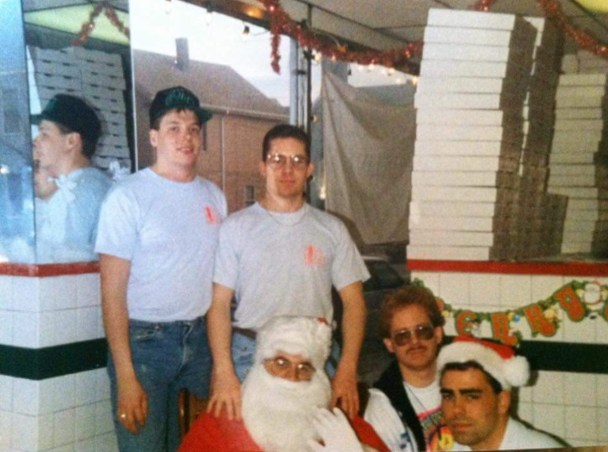 MERRY PIZZA: Pisa Pizza owner Joe Crowley is pictured with Santa during a visit by St. Nick at the Highland Ave. store.