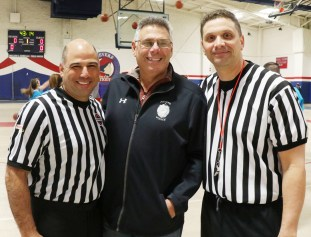 Reffing for the game Parks and Rec Director Mike Hinojosa and a special visit at center court by Police Chief James Guido