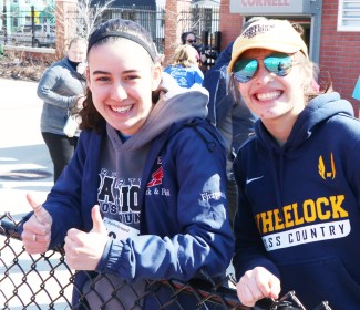 RHS Track Star Hannah Fitzpatrick and former RHS Track Patriot from Class of 2017, Monica Posada.