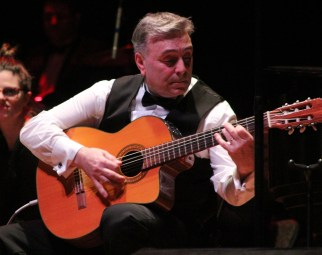 Joseph Freda performs a classical guitar solo during last Saturday's show at the Lynn Auditorium.