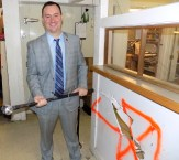 Mayor Edward Bettencourt took the first swing at the kitchen wall during the April 6 groundbreaking event to renovate the existing kitchen at Citizens Inn's Haven from Hunger program.