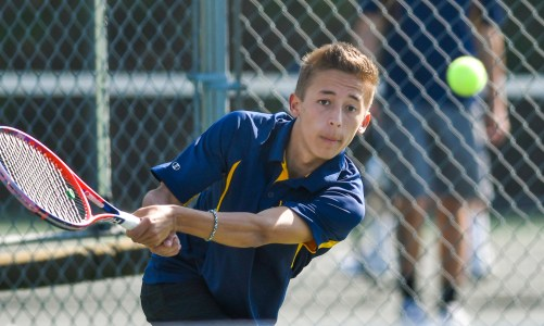 Lynnfield's second singles player Arlex Correa keeps his eyes on the ball during their match against Ipswich at Ipswich High School on Monday, May 7, 2018.