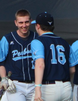 Peabody's Trevor Lodi is congratulated by Eddie Campbell after scoring on Ryan Knight's two-run triple.