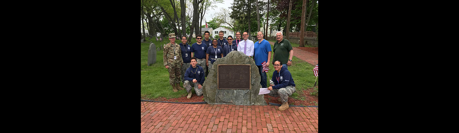 RHS Army JROTC plants flags for Memorial Day at Rumney Marsh Burial Grounds