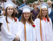 Big smiles from grads, Ally Ciano and Mackenzie and Madison Cunningham.