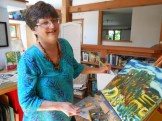 COLORS OF THE MARSH: Local artist Kelly Slater in her home art studio this week, showing the picture she painted during a visit to Rumney Marsh. Slater's artwork and conservation knowledge has inspired the Saugus Action Volunteers for the Environment (SAVE) to sponsor its first annual Rumney Marsh art exhibition in September. A close-up of the painting is at right. (Saugus Advocate Photos by Mark E. Vogler)