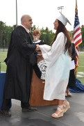 School Committee Chair Jamie Hayman presents a diploma to Hailey Castinetti.