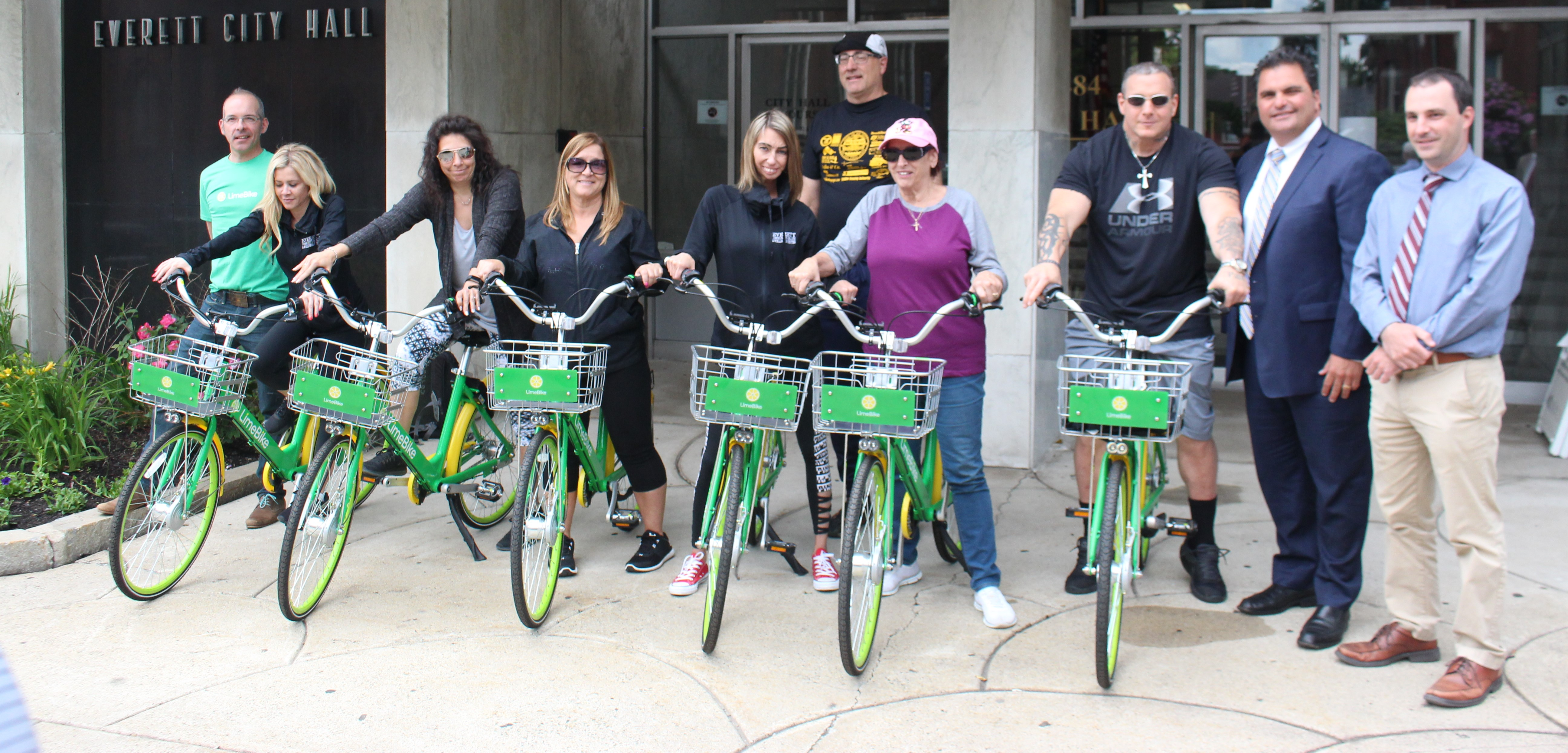 Mayor Carlo DeMaria, Malden City Councillor Steve Winslow, Transportation Planner Jay Monty, Scott Mullen of Lime Bike, Wellness Center Employees and residents are shown with the city's new Lime Bikes during the unveiling ceremony Thursday afternoon.