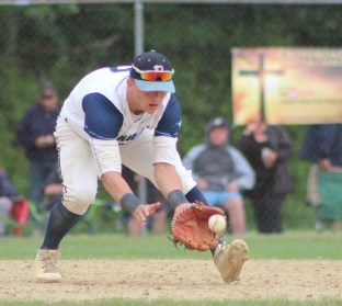 Tanner shortstop Jake Gustin scoops up this hard ground ball in last Thursday's 3-1 tourney win over Lawrence.
