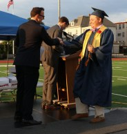 Class Treasurer James O'Donnell receives his diploma from Mayor Brian Arrigo.
