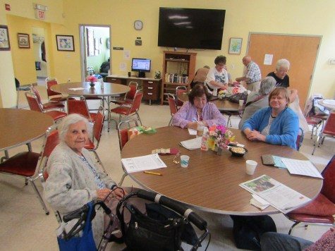 Eleanor Cerabone, Jeanette Trionfi, and Kathy Haley, regular participants of the Rossetti-Cowan Senior Center, love to try their hand at brain teasers, word games, puzzles, and other mind-stimulating exercises. It is also a major part of the Auction requirements that takes place each month.