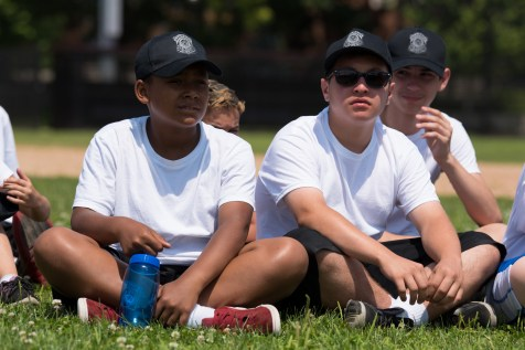 Lian Dorosario and Christian Serrano sat on the grass at Glendale Park with fellow students in the Junior Police Academy
