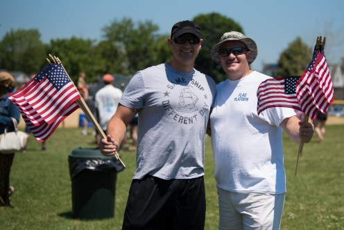 Navy Veteran Daniel Apollo and Revere's new Director of Veteran's Services and Army Veteran, Marc Sylvestri, handed out American flags to attendees on the 4th of July