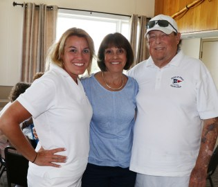 Asst. Vice-Commodore Jill Simmons-Wetmore with her parents and life members of the PPYC, Judi and Steve Simmons..