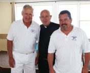 Commodore Jack Galncy and Asst. Commodore Jay Bolton are shown with Father Richard Uftring. The Blessing of the fleet at the PPYC is a very big day at the club and Father Uftring enjoys his time there with the members.