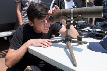Michael King adjusted a telescope to take a close look at the Blackhawk helicopter in Glendale Park