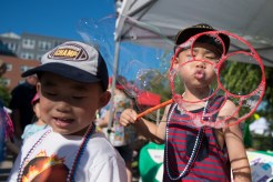 Eric and Allen Chen blew bubbles into the crowd on Saturday