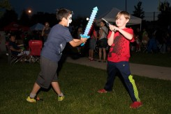 Kevin Pham and Dillon Brescia battled using their light up swords on the grass before the fireworks show on Saturday evening