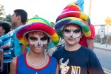 Joshua Lopez and Cowell Pattelena showed off their colorful emoji hats and face paint