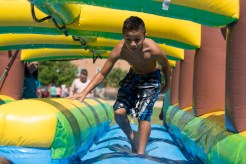 Ethan Esmurria raced down a slip 'n slide to cool off from the summer heat