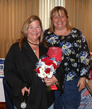 Kathleen O'Donnell (right) presented flowers to Denise Anderson for all her hard work during the season.