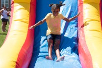 Izabelle Briggs made a splash on the inflatable waterslide set up on the 4th of July