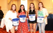 The seniors became members of the blue bucket brigade, Mackenzie Cunningham, Victoria Correia, Melaina Polan, and Madison Cunningham. Buckets were used to peek over the cage during the game, but these buckets however are filled with treats.