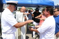 Father Richard Uftring blesses the water, with assistance from Commodore Jack Glancy and Asst. Commodore Jay Bolton.