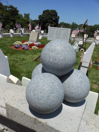 NEW AMMUNITION: Two new piles of four granite cannonballs are now part of the wall at the entrance to the Civil War veterans' burial plot at Riverside Cemetery. U.S. Army veteran Nick Milo, a mechanical engineer who has worked on many veteran monuments around town pro bono, volunteered his time on the design of the cannonballs and their installation.
