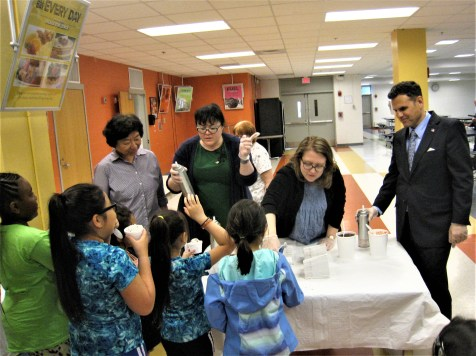 SERVING SUNDAES--Mayor Gary Christenson, far right, gets ready to serve free ice cream at Malden High School recently. A large throng enjoyed the treat, provided by Dairy Delight, of Malden. (Photos by Charles Harrington)