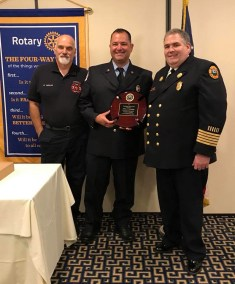 Firefighter Jeffrey Fiorentino (center) received this year's Firefighter of the Year Award on June 28 at the Rotary Club Luncheon. He is pictured with last year's recipient, Firefighter Ronald Cataldo (left), and Fire Chief Mark Tetreault (right).