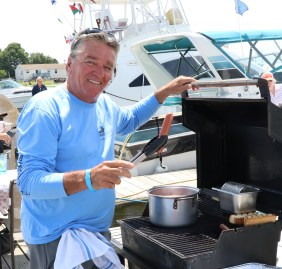 Get 'em while they're hot, Steve DiChicco up from Florida to cook up some great hot dogs for the occasion.