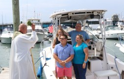 The O'Donnell family gets their blessing last Saturday afternoon, James, his mom, Kathleen, dad, Jimmy (a PPYC Trustee) and his sister, Katie.