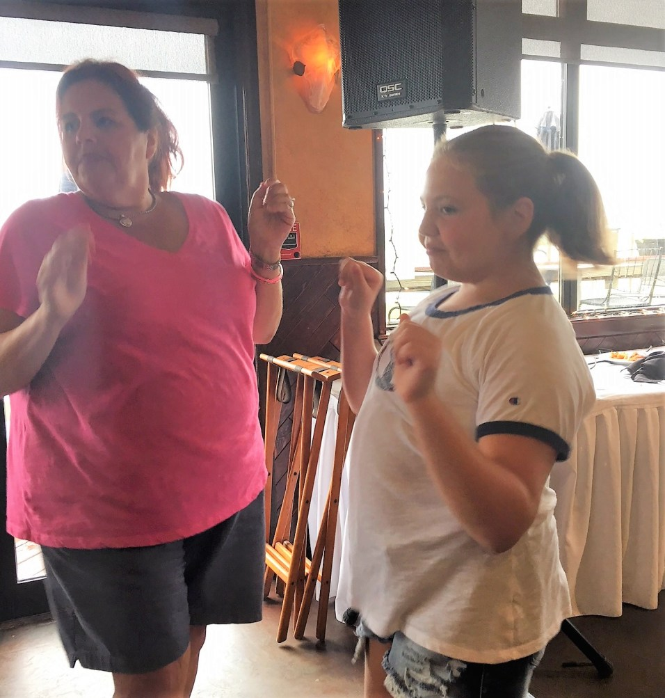 Revere residents Michele Misano-Harris and her daughter, Olivia, 11, dance to Vinyl Groove, a disco '70s band, at the Marina on Saturday afternoon.