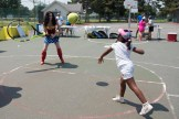Bethany Yilkal reached out to catch a giant tennis sent her way by Wonder Woman.