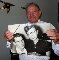 A GIFT OF WAR: Something great happened to Donald Patti when volunteered as a U.S. Marine to go to Korea in 1952. He wound up going to Japan instead, where he met his wife to be – Hisae Nakata. Patti, in his living room this week, displays a photo of him and his late wife, who died four years ago. (Saugus Advocate Photo by Mark E. Vogler)
