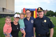 Mayor Brian Arrigo is shown with his wife, Daveen, sons, Joseph and John, and Captain Collyer at National Night Out.