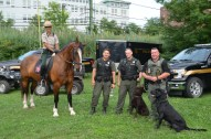 DCR Ranger Kristen Mincey atop her horse, Cowboy is shown with Mass. Environmental Police K-9 Unit members, from left; Joshua Vinal, Travis Huard, and Art O'Connell with K-9's Jett, left, and Moose.