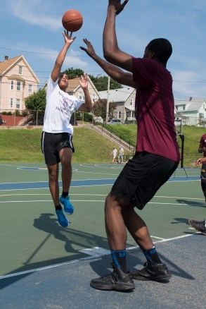 Zavier Dunbar made a shot during the 3-on-3 basketball tournament at Florence Street Park on Saturday.
