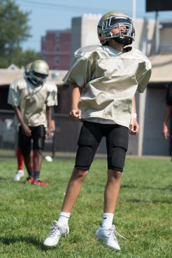 Everett Pop Warner players practiced on the sidelines during the scrimmage on Sunday.