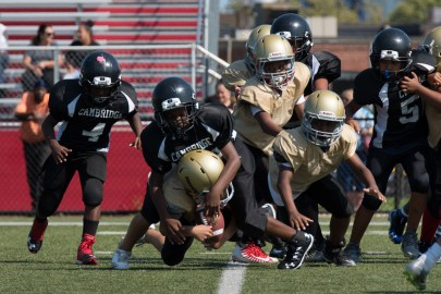 Everett protected the ball in a scrimmage against Cambridge on Sunday.
