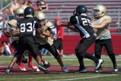 Everett Pop Warner made an effort to protect the ball from the Cambridge team.