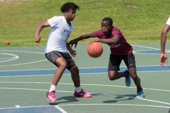 Christian Molan and Stephon Clarizie faced off in a 3-on-3 basketball game at Florence Street Park on Saturday morning