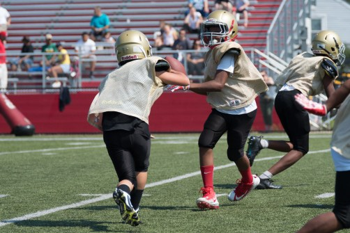 Everett youngsters learned the ropes of football during a jamboree at Everett Memorial Stadium.
