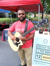 TIME FOR SOME MUSIC: Sopeep Bou, of Saugus Community Events, plays his guitar.