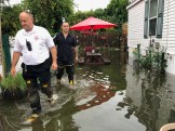 ASSESSING THE FLOOD DAMAGE: Left to right, Saugus Fire Captain Scott Phelan and Firefighter Michael Ferreira wade through the flood waters at the Saugus Mobile Home Park on Tuesday after torrential rains inundated the park with water. (Courtesy Photo to The Saugus Advocate by Lt. Damian Drella of the Saugus Fire Department).