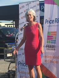 Congresswoman Katherine Clark praises volunteers and contributors to the backpack and food drive for needy students, organized by Price Rite Marketplace and Feed the Children, together with event partners Nabisco and Pepsi during a ceremony Thursday morning.